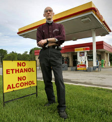 "Eric ""Ric"" Foster won't sell ethanol at his Gardner gas station. But his supplier has said if he wanted to sell regular gas, it would be E-10 or nothing. ""I'm going to fight this tooth and nail,"" Foster said."