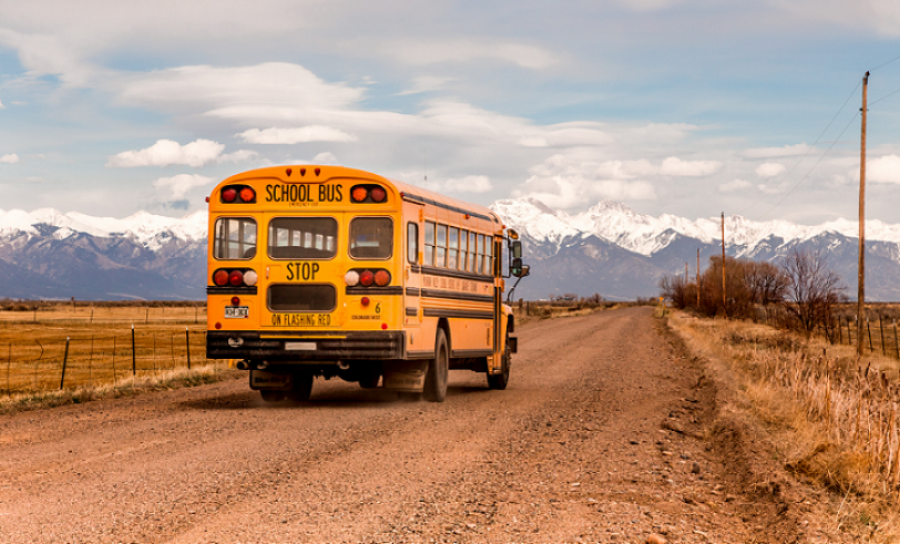 School bus driving on rural road