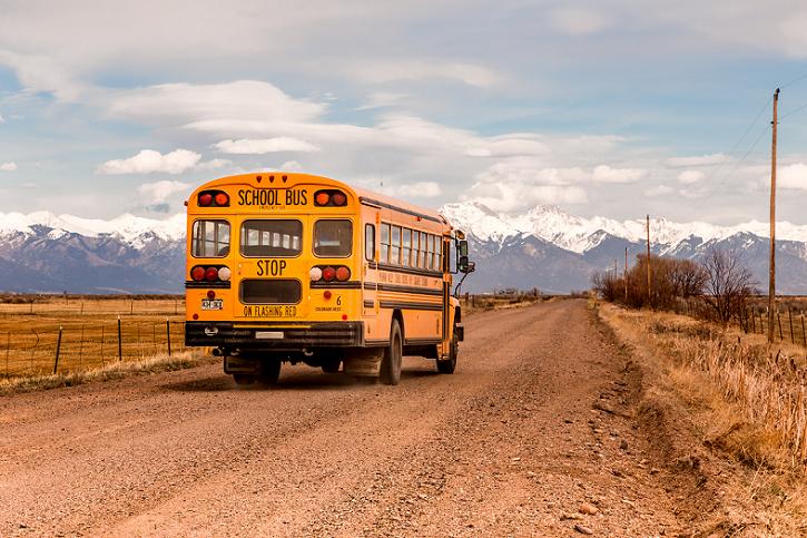 School bus driving on rural road
