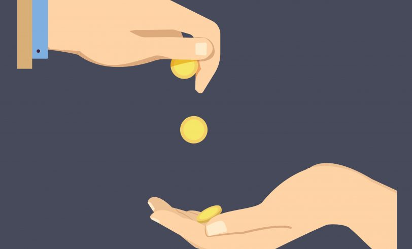 Coins dropping into hand