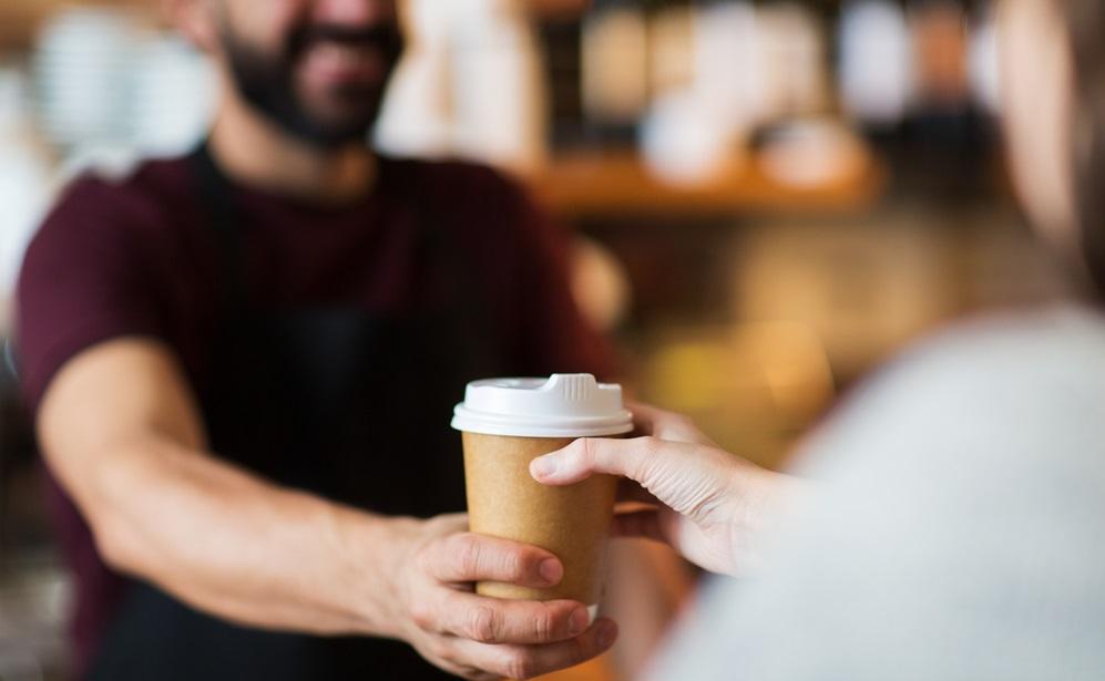 Customer taking cup of coffee