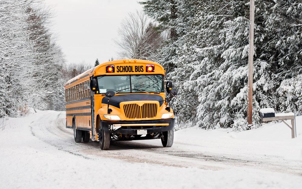 School bus on road in winter