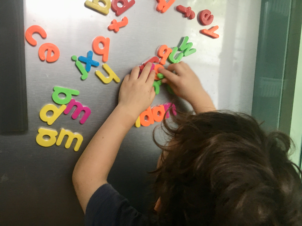 Kid with letters