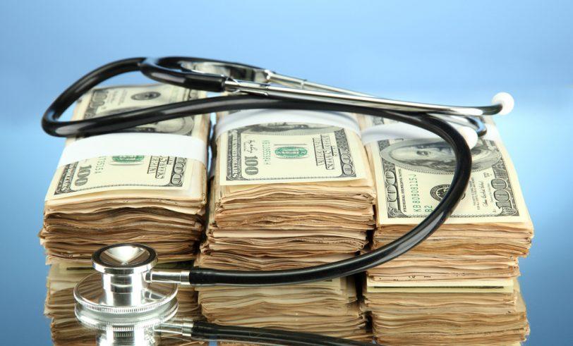 Stethoscope around stacks of bills