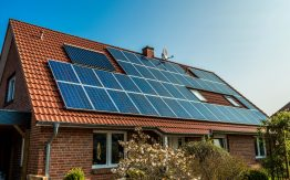 House with solar panels>