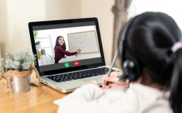 Child learning remotely>