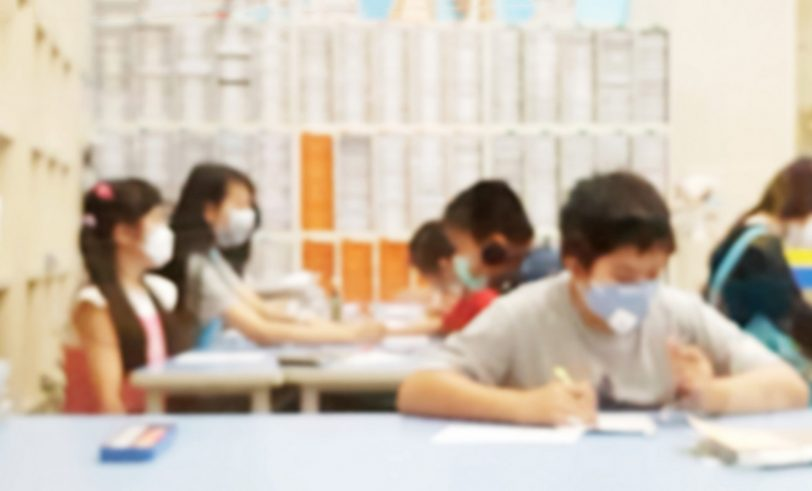 Masked students in classroom
