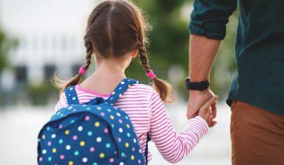 Parent walking child to school>
