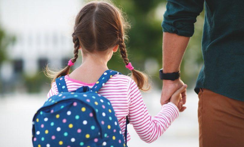Parent walking child to school