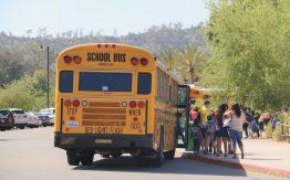 School bus dropping off kids>
