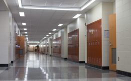 Empty school hallway>